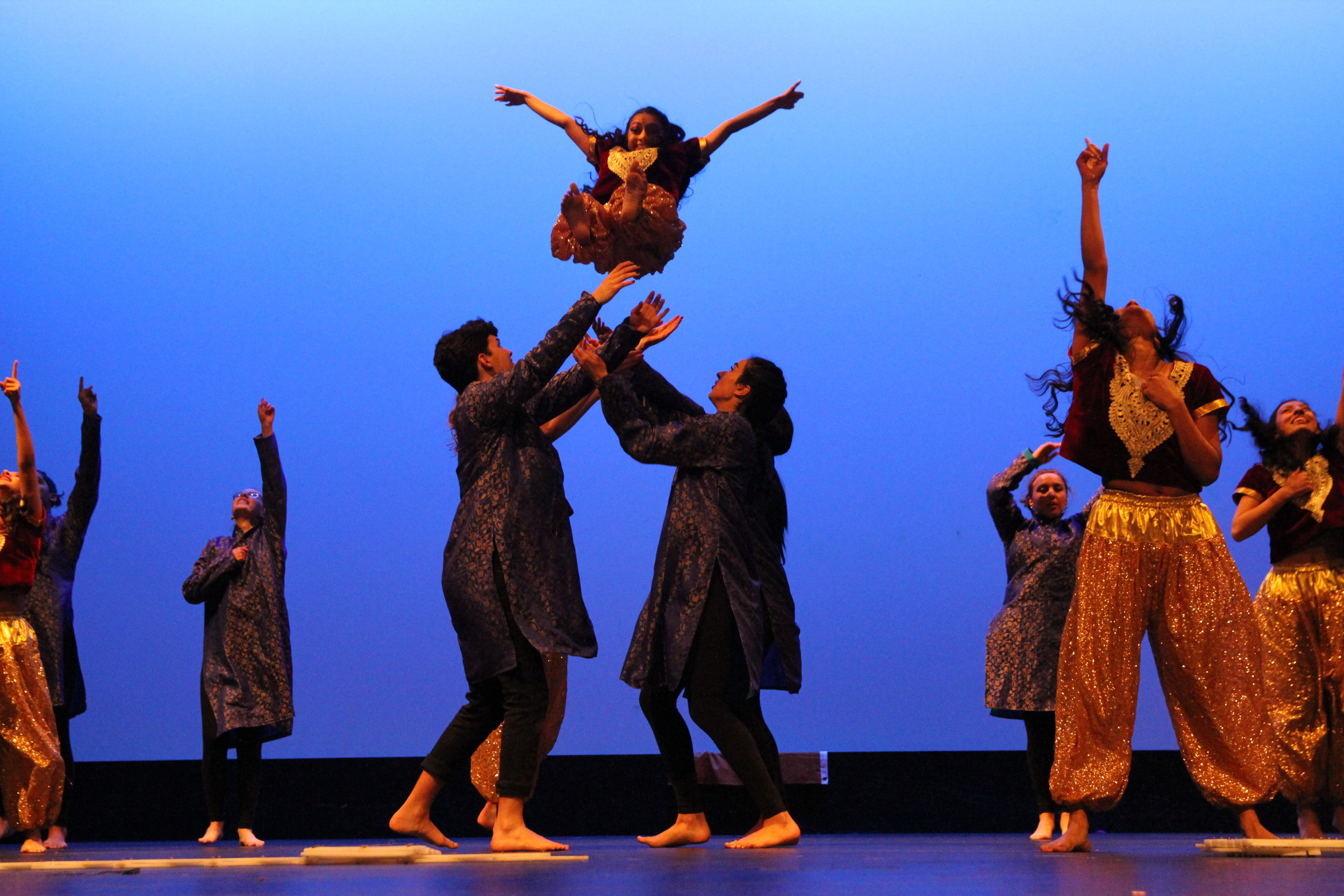 A dancer is thrown into the air and caught to end this sensational night of dances from the diverse dance groups that make up Northside College Prep International Night
