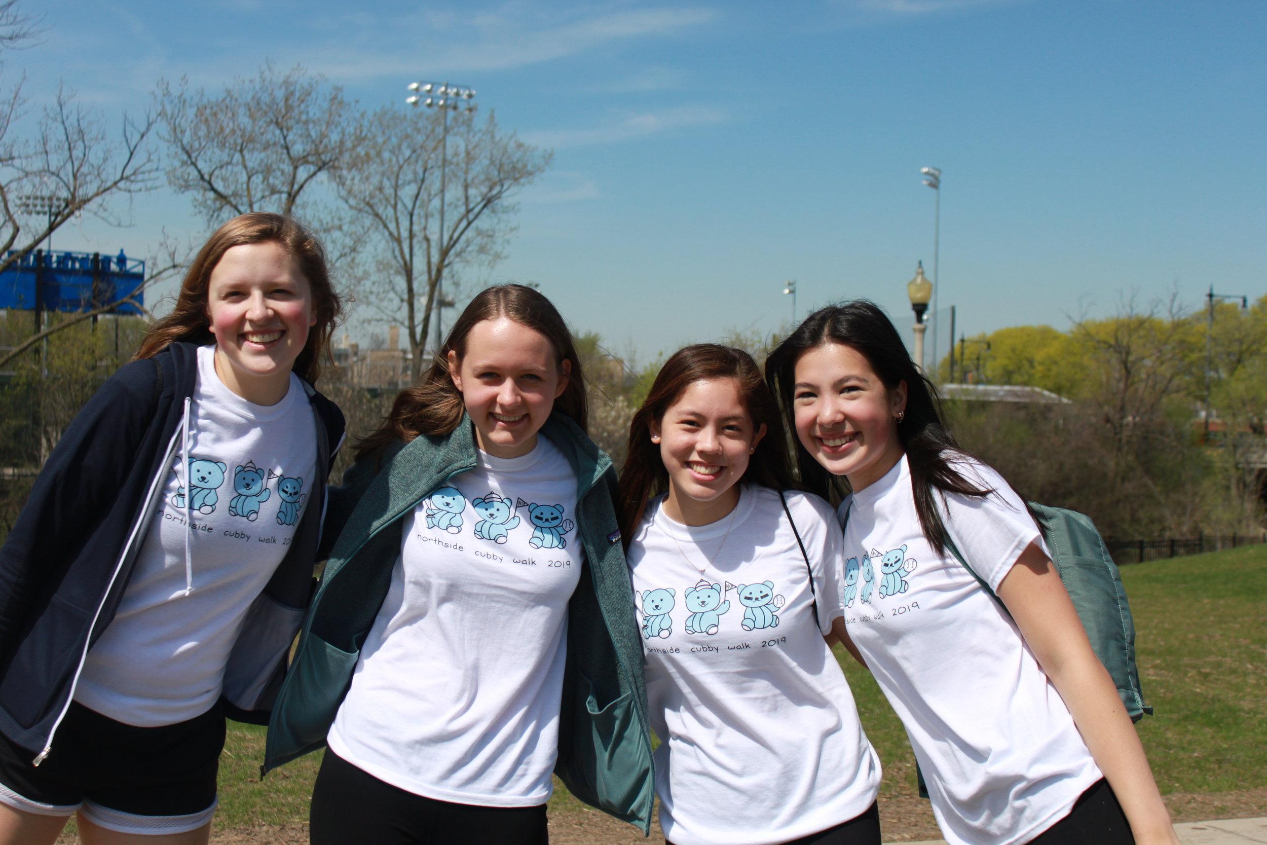 Junior participants show off their Cubby Walk shirts
