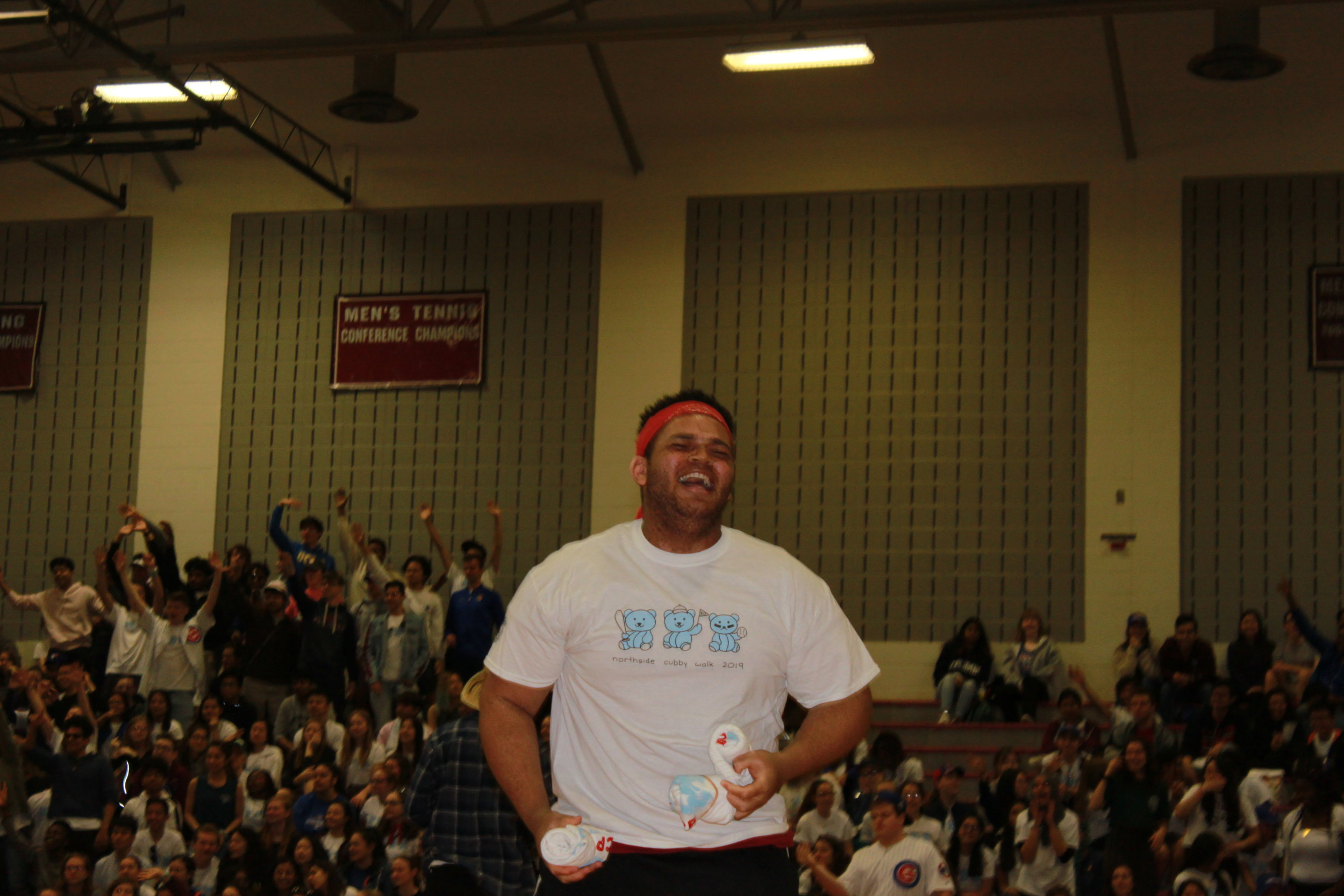 One of the emcees, Donovan Holt, Adv. 907, throws t-shirts at the crowd.