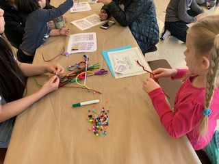 The cafeteria held the youngest children were they could design friendship bracelets with the help from students in the Northside art community.