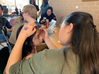 Students artist were in charge of the face painting station. You could see painted faces throughout the event.
