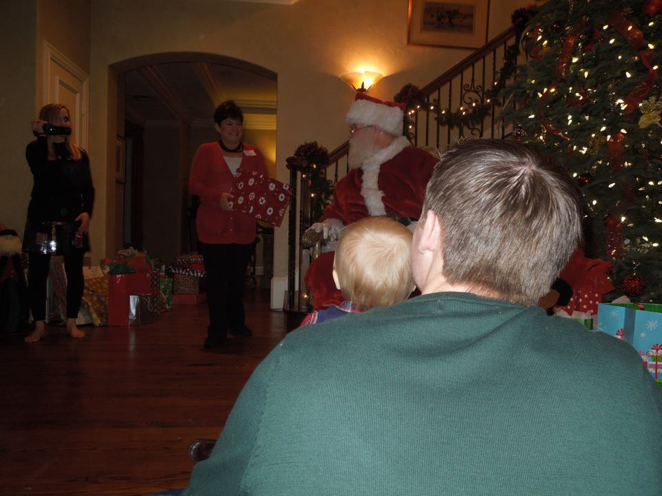 Mom bringing Santa a present for one of the cousins!