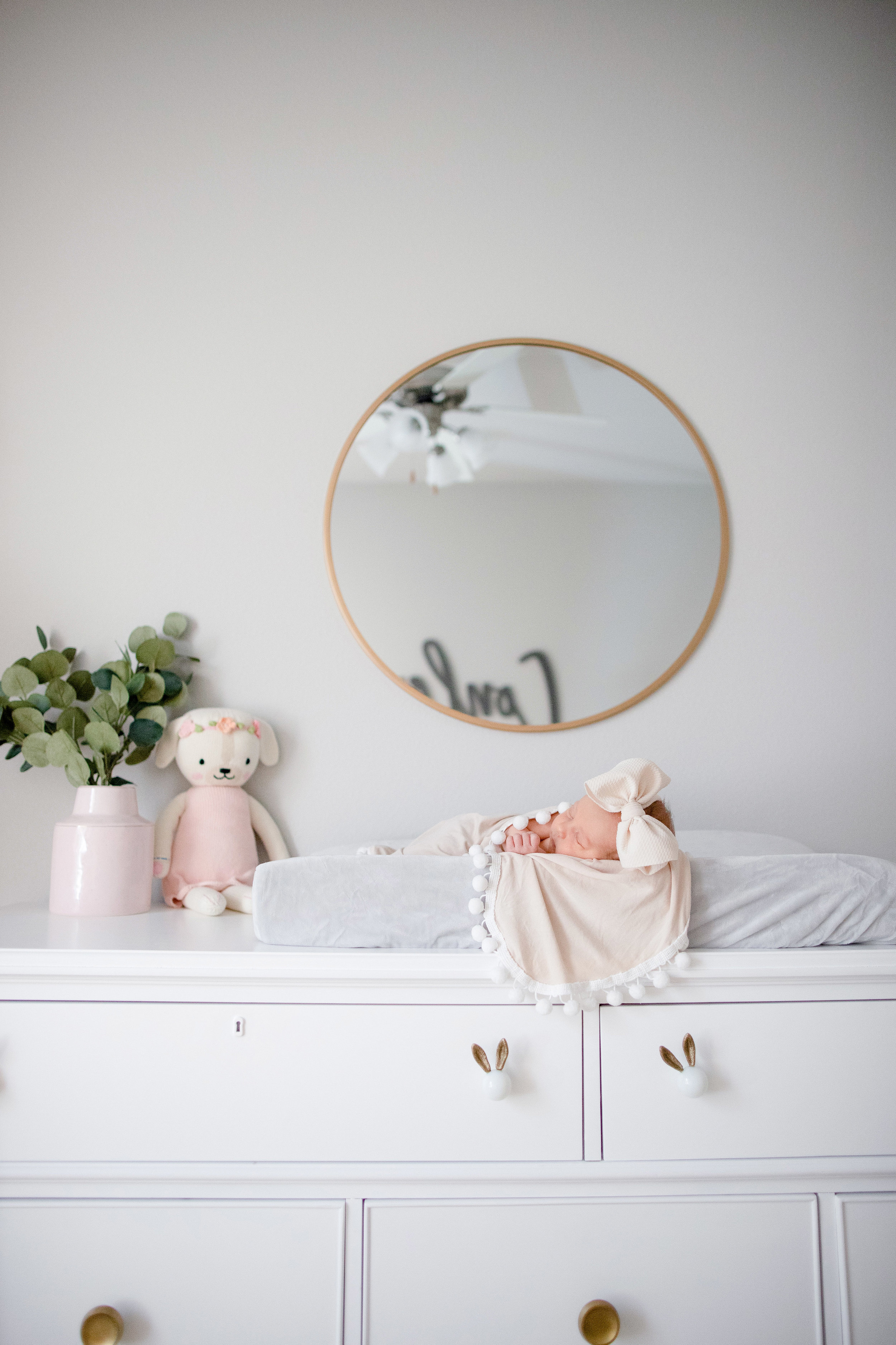 This dresser was mine from college. it was an antique cream distressed color that we had painted white and then added new hardware from Anthropologie.