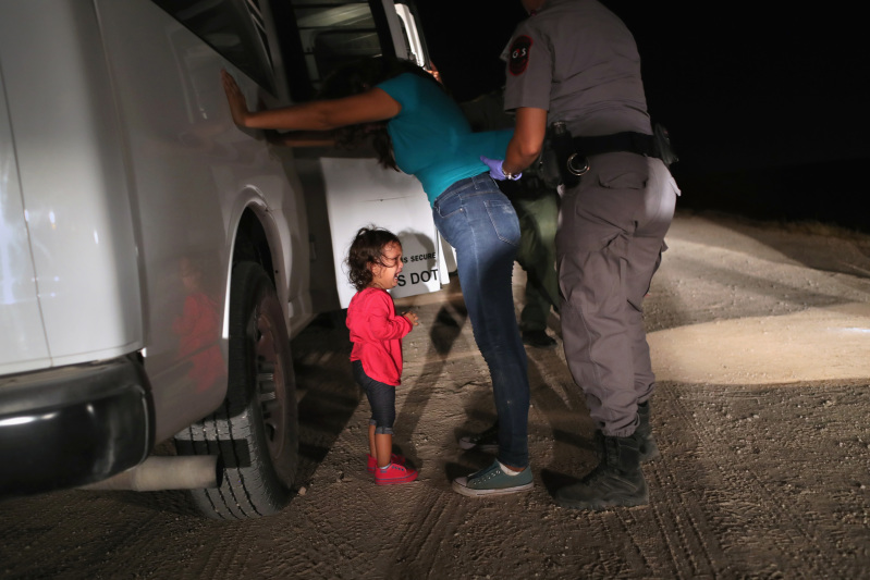 Immigrant child crying as her mother is arrested.  Photo courtesy of Getty Images.