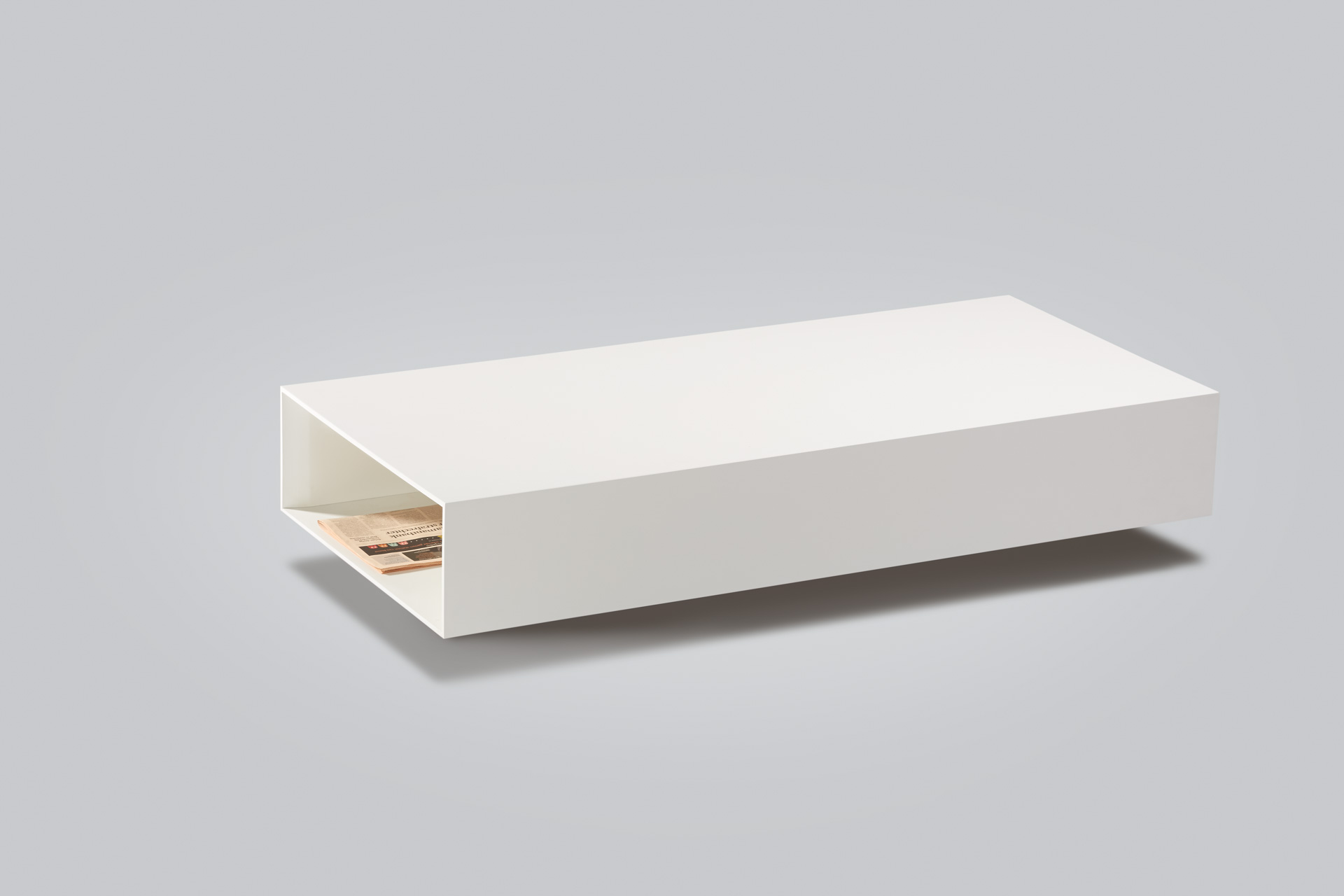 Product foto van strakke witte salontafel