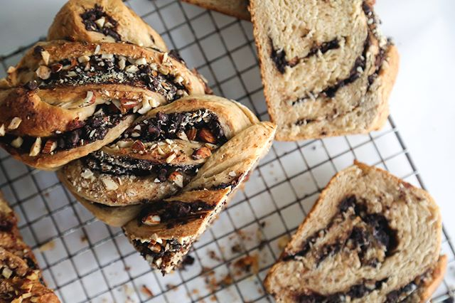 Hey, @food52 check out these swirls #f52swirl Cinnamon-scented sweet dough turns into the best babka, one is filled with Dutch process cocoa, mini chips, and almonds, and the other has a syrupy brown sugar fillings with raisins and walnuts 🌀 #twobrunchgirls #homemade