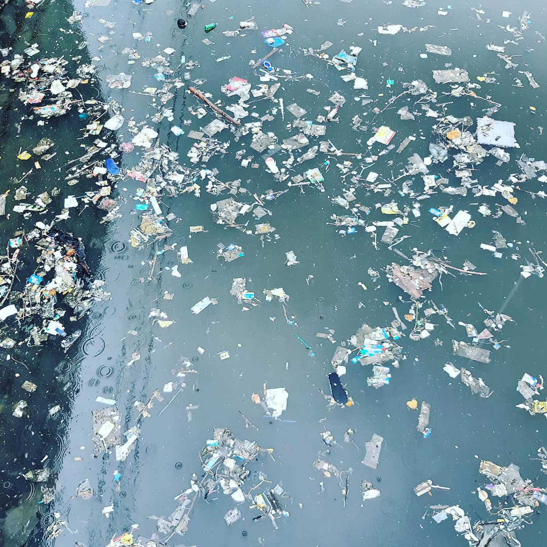 View of the plastic continually flowing into the ocean down the Pasig River.