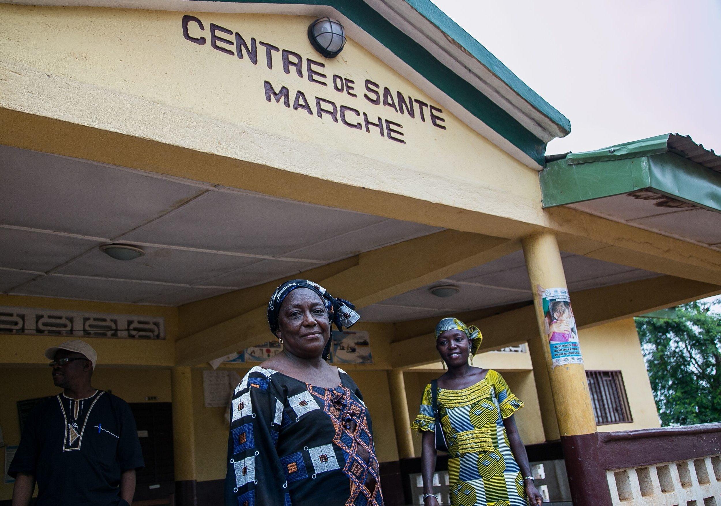 Women outside of a health center in Faranah, Guinea.  Photo: Patrick Adams