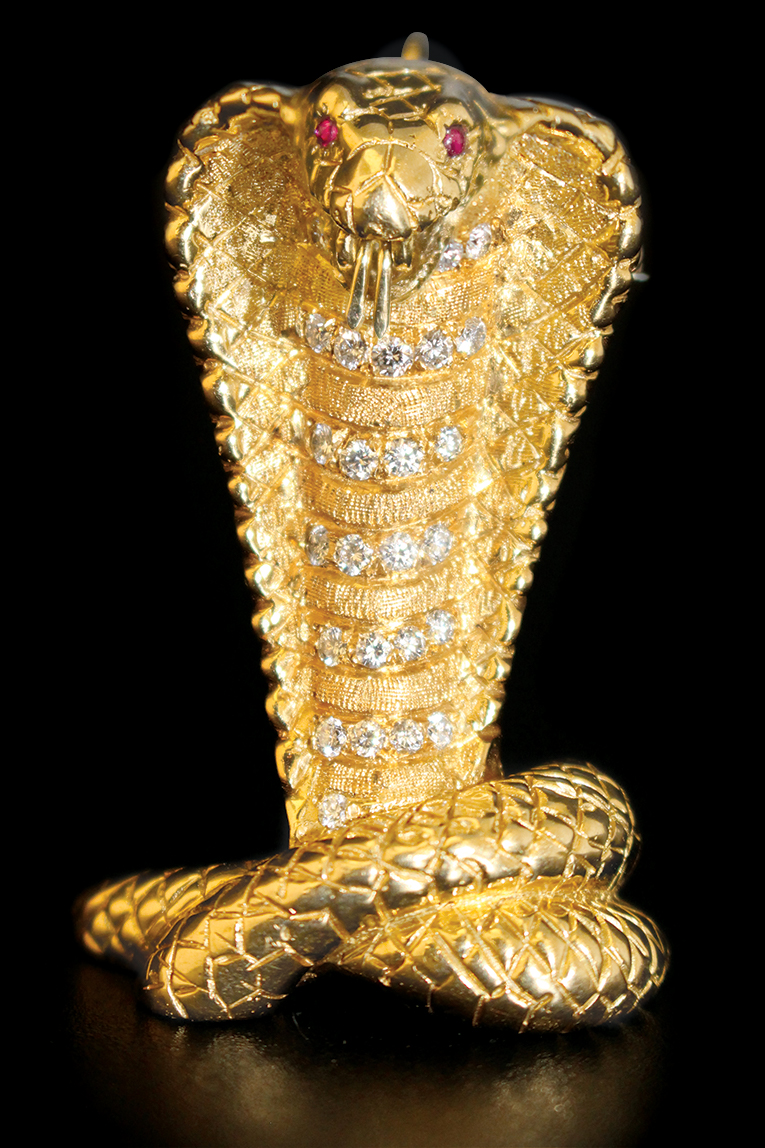 Cobra gold pendant / pin with diamonds and rubies once belonging to Sylvester Stallone.