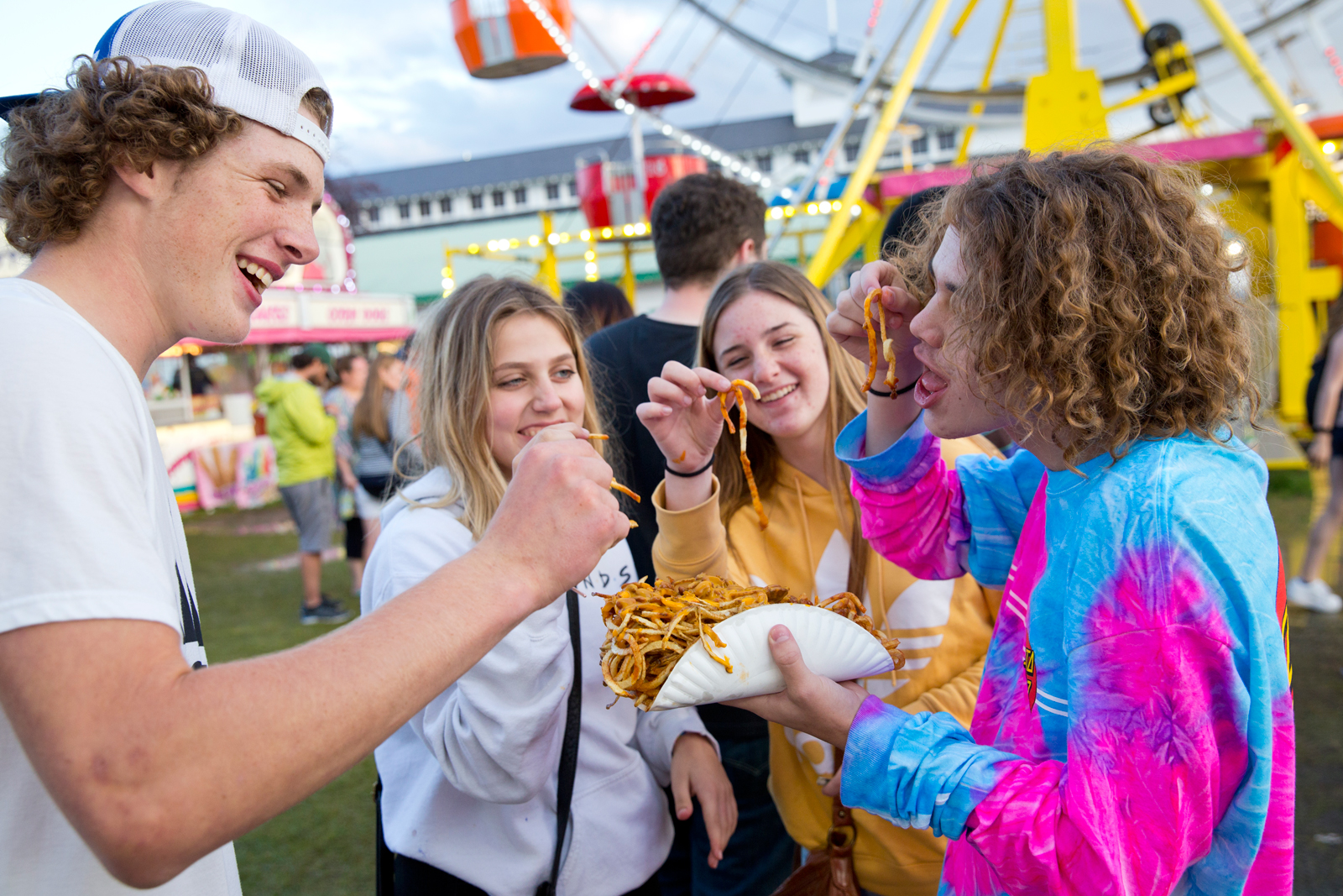 Photo by Bess Bird. Teenagers share in heaping portions of french fries.
