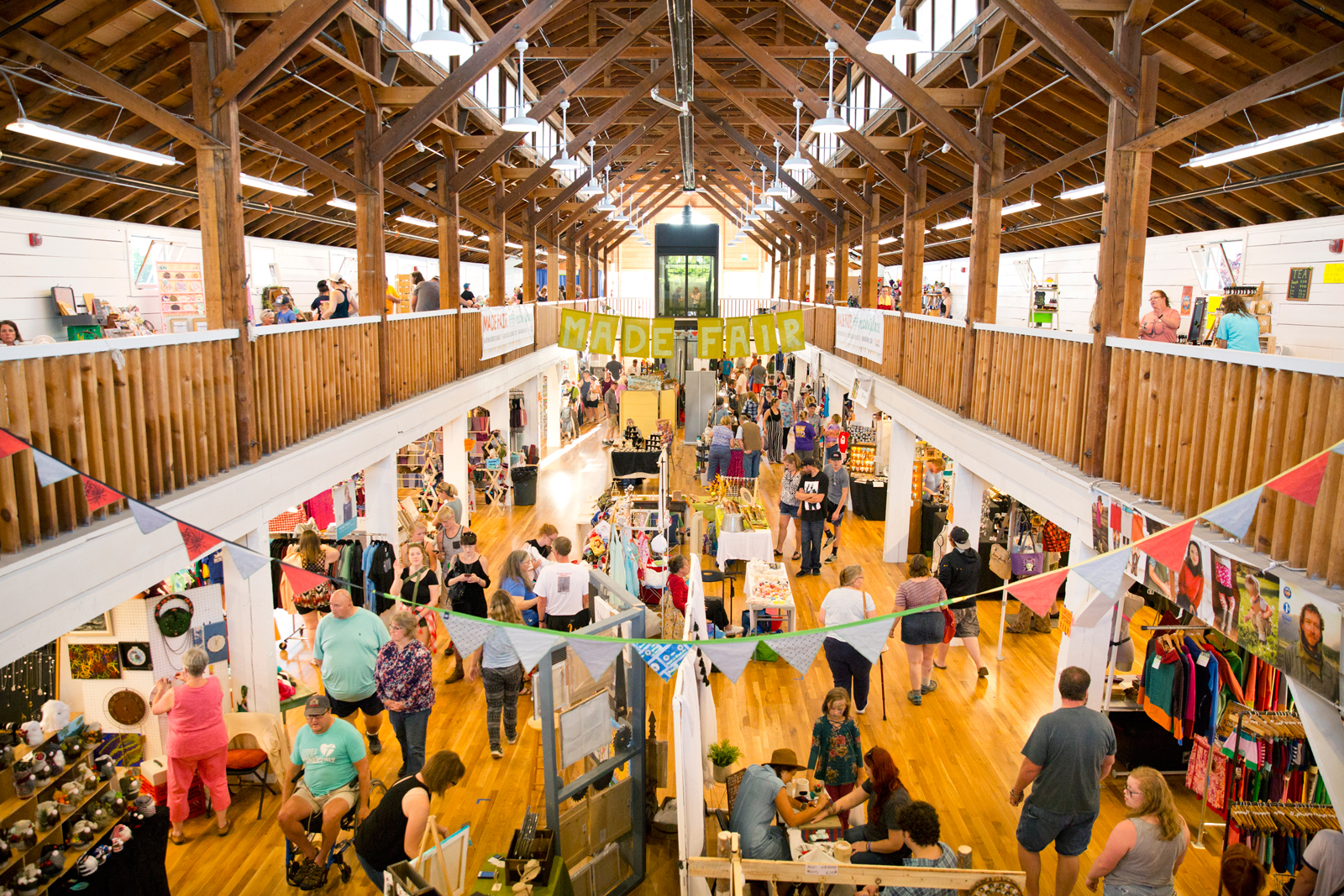 Photo by Bess Bird. The Made Fair Marketplace helped to debut the remodelled Commercial Building, filling both floors with local/handcrafted arts and goods. New elevator rear/center.