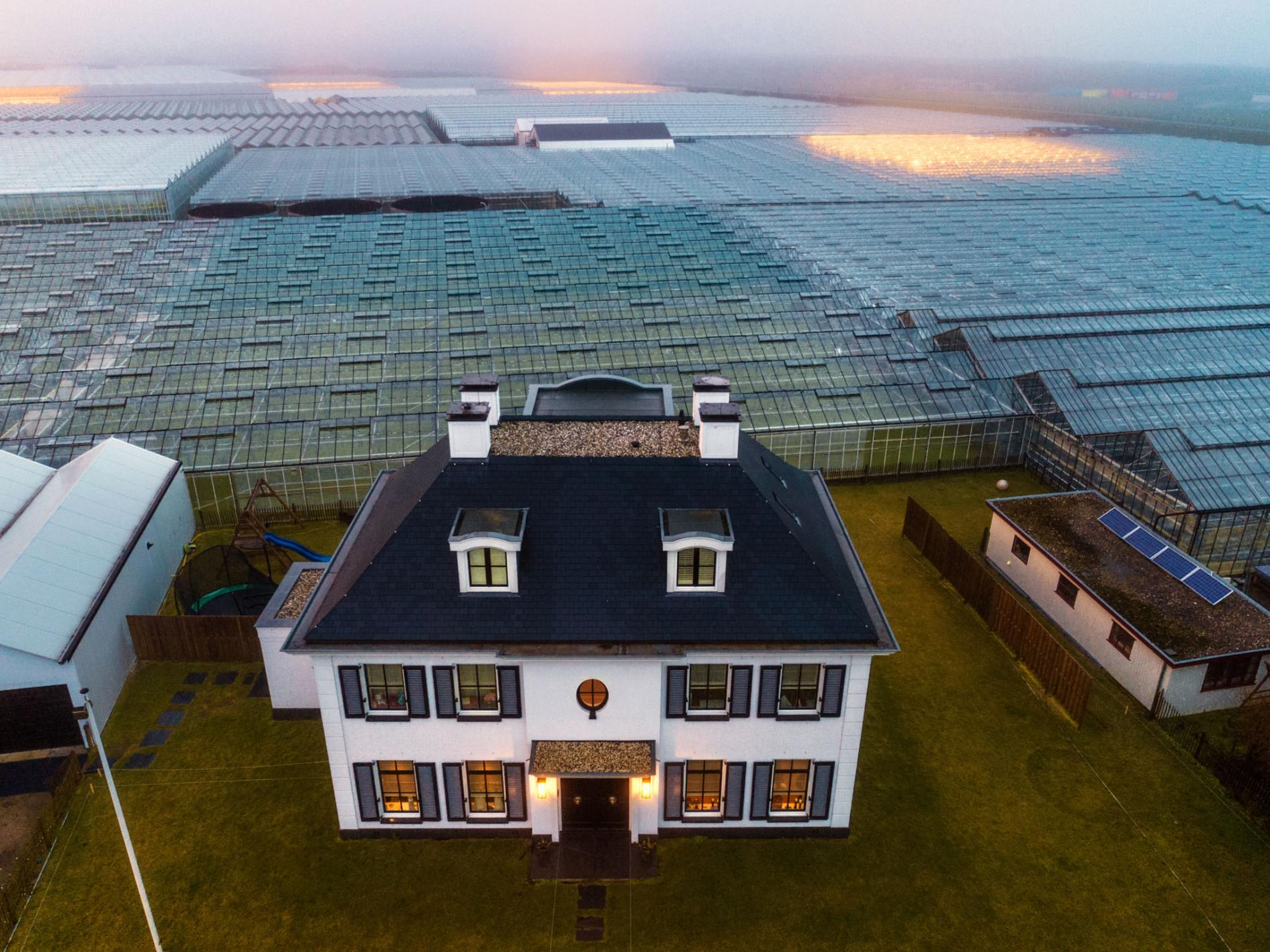 A sea of greenhouses covers much of the Netherlands' Westland region, which accounts for more than half of all horticultural production in the nation. Photo by  National Geographic