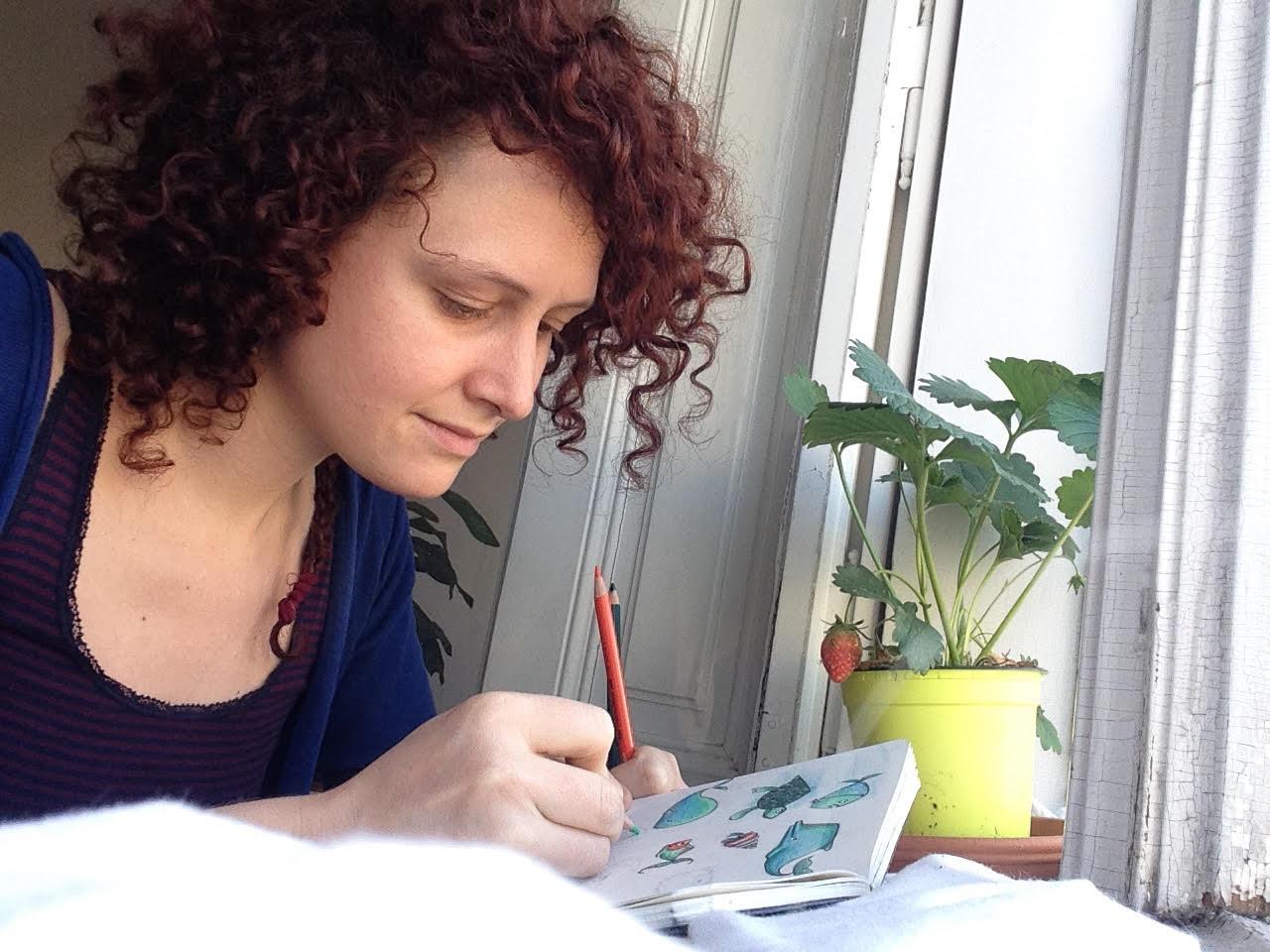 Sonja sketching at her desk.