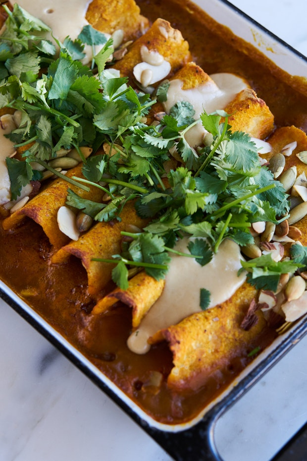 The dish comes together quickly thanks to an easy pumpkin based sauce, and a filling that relies on a can of black beans. Photo from  Heidi at 101 Cookbooks.
