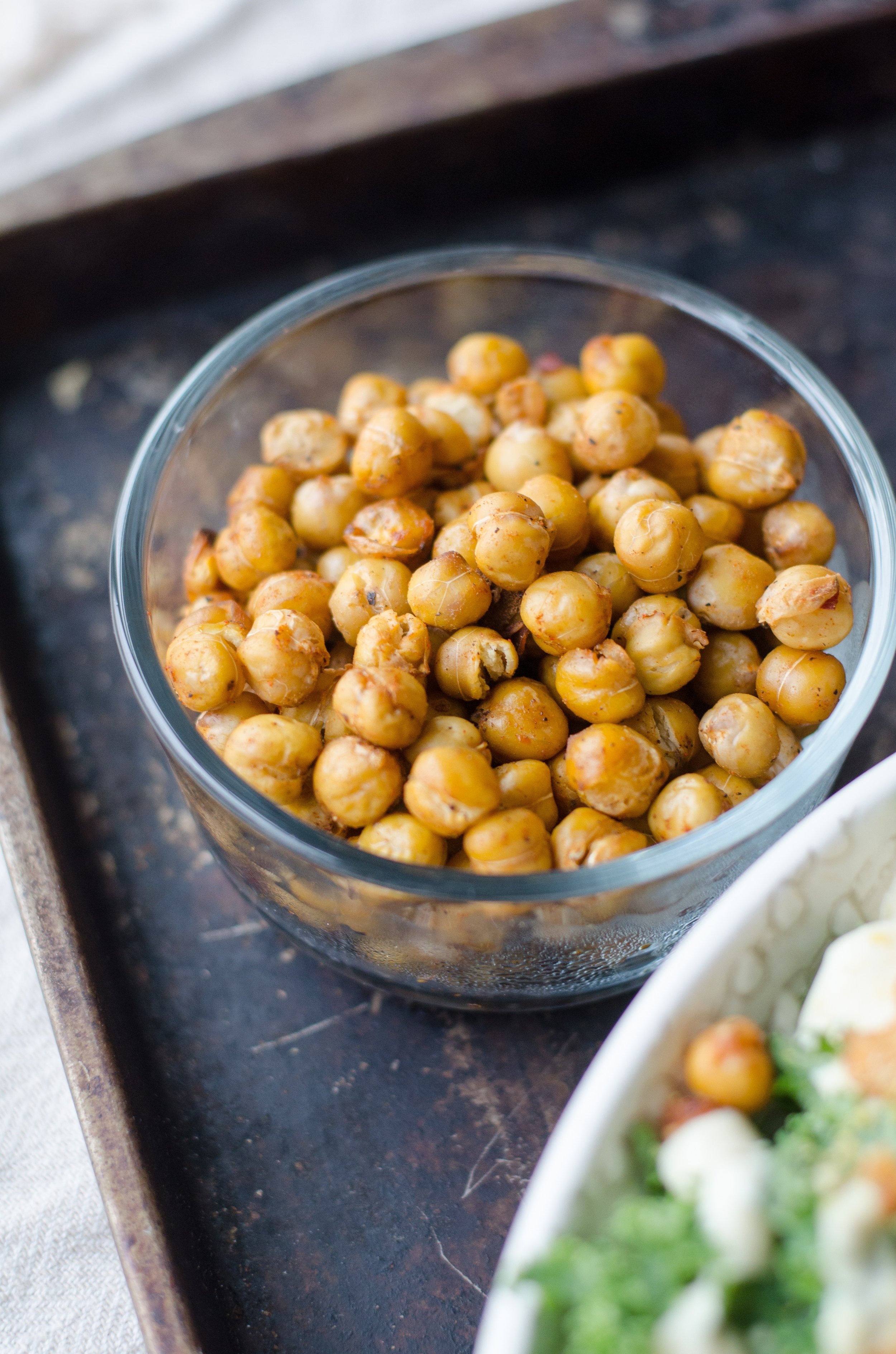 These tiny crispy beans should really be the new bar nuts. Two cans of chickpeas and about 20 minutes will yield addictively salty crispy bites. So what are you waiting for?
