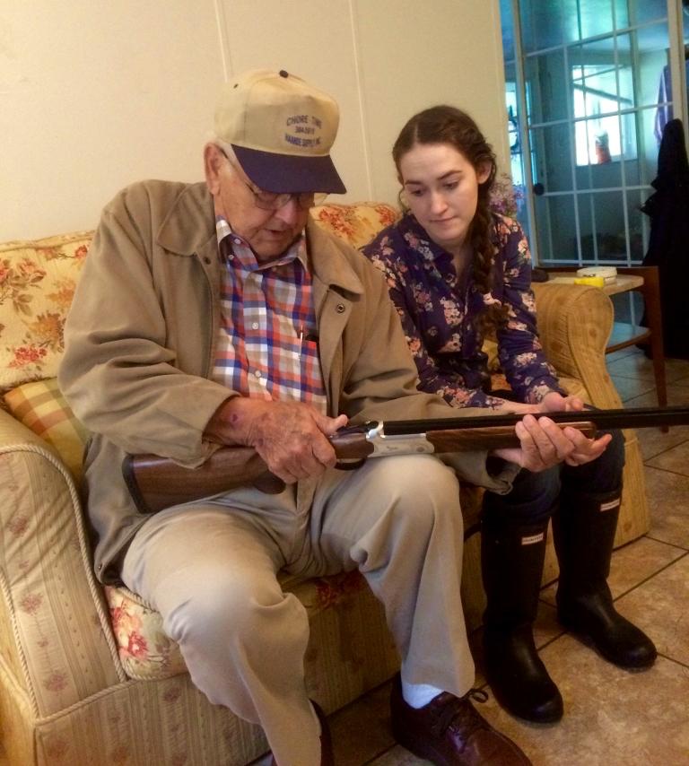 Papa explaining how to use the shotgun to help control predators.