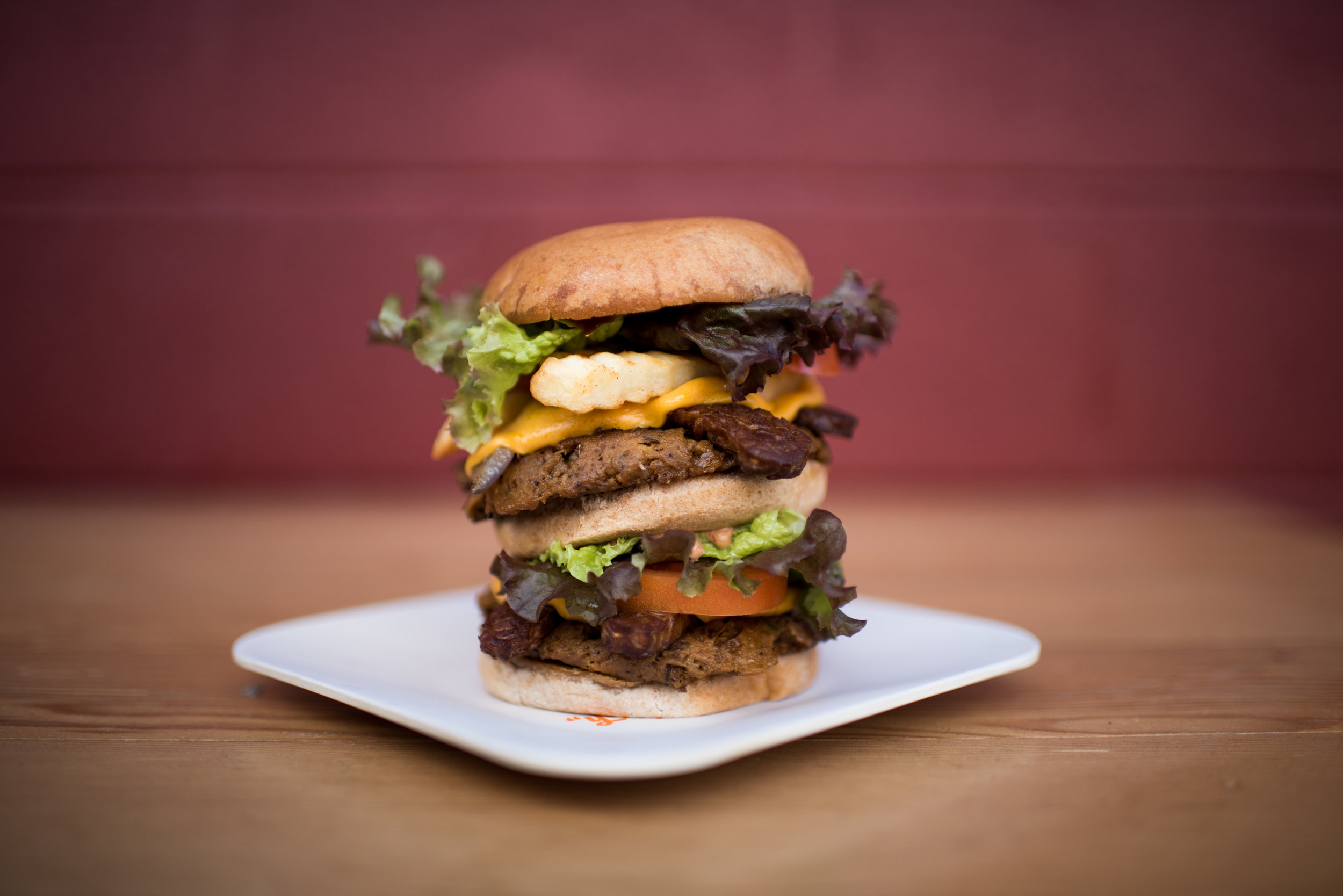 Next Level Burger opened in 2014 flaunting a completely plant-based menu of burger joint classics, like the Animal Burger, pictured here. Now on its way to national expansion, the company joins a growing number of meat-free burger ventures working to change the way Americans eat. Photo from  Next Level Burger