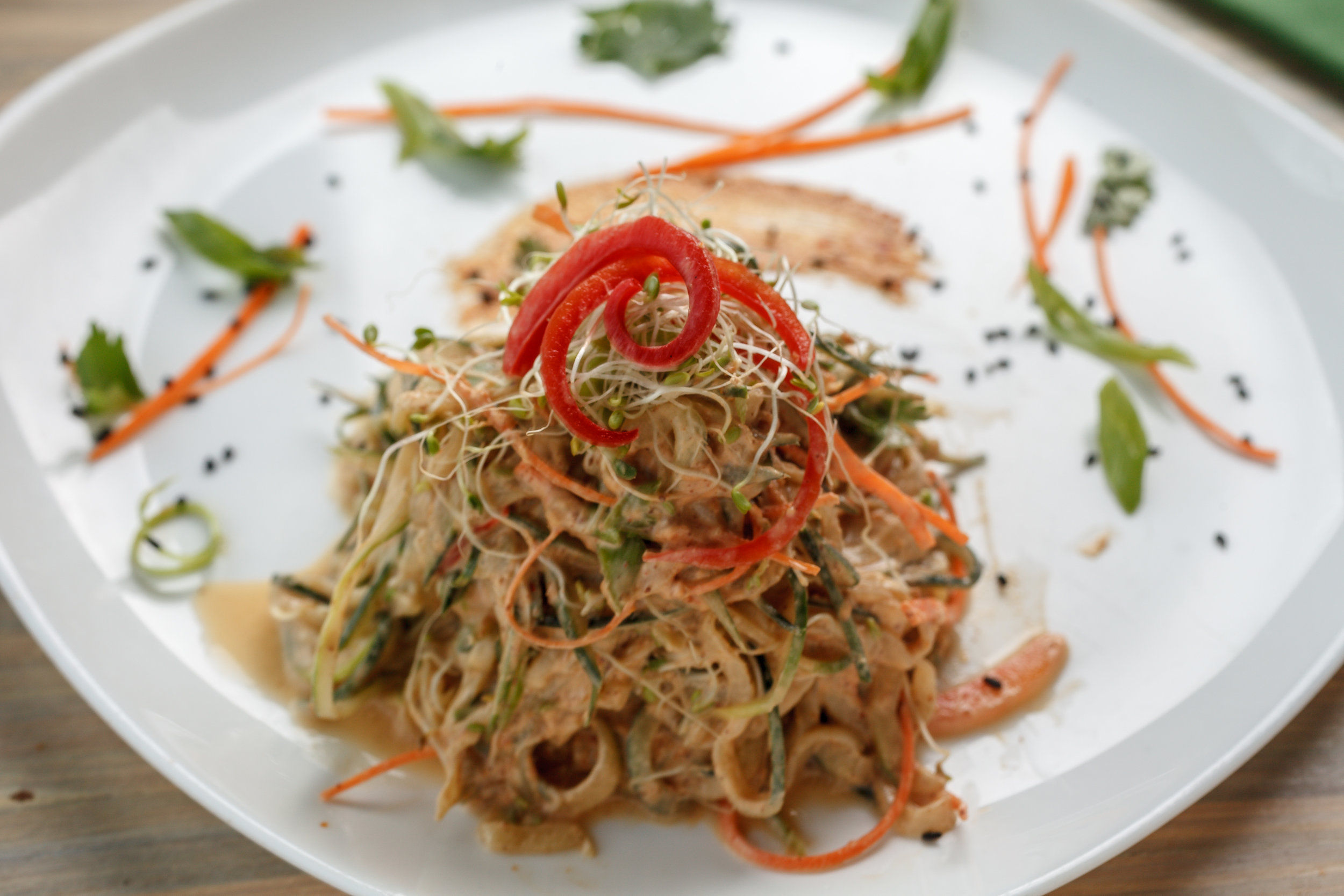 At New Orleans-based Seed, Edgar Cooper is serving vegan dishes with southern flare. The one pictured here is a Raw Pad Thai, made with spiralized cucumber noodle and an almond butter-tamarind sauce. Photo from  Seed