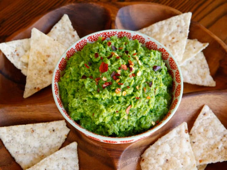 Photo Source.  This guacamole is a great last minute dinner party appetizer, in part, because it's so adaptable - you can use fresh or frozen peas, substitute lemon for lime juice, and spice it up however you'd like. All it takes is a a food processor and a few minutes of your time. Serve it with a variety of accompaniments - tortilla chips, whole grain crackers, even toasted crostini will do wonders for it.