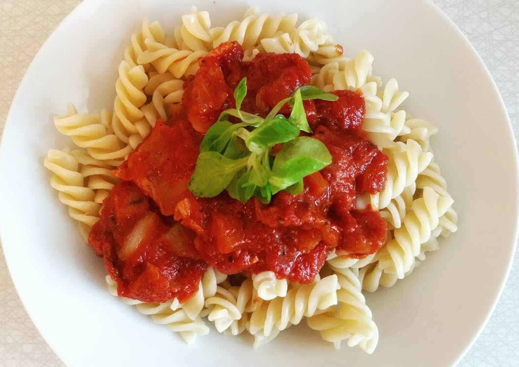 Packed with both dried and fresh oregano, this tomato sauce has a healthy dose of herbs. Good sauces are layered with flavor, so be sure to season at every step and use high quality ingredients. Canned tomatoes are preferable because they have less water content, but experiment with fresh if you have an abundance on hand. Serve with your favorite fresh pasta for an easy weeknight meal.