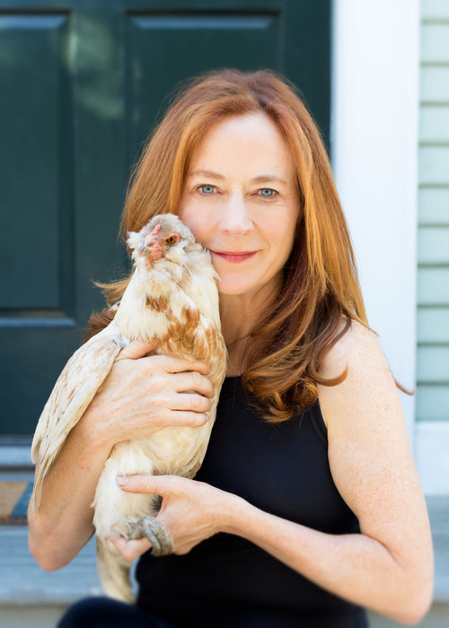 Author Leslie Crawford and Alice, one of her six backyard chickens.