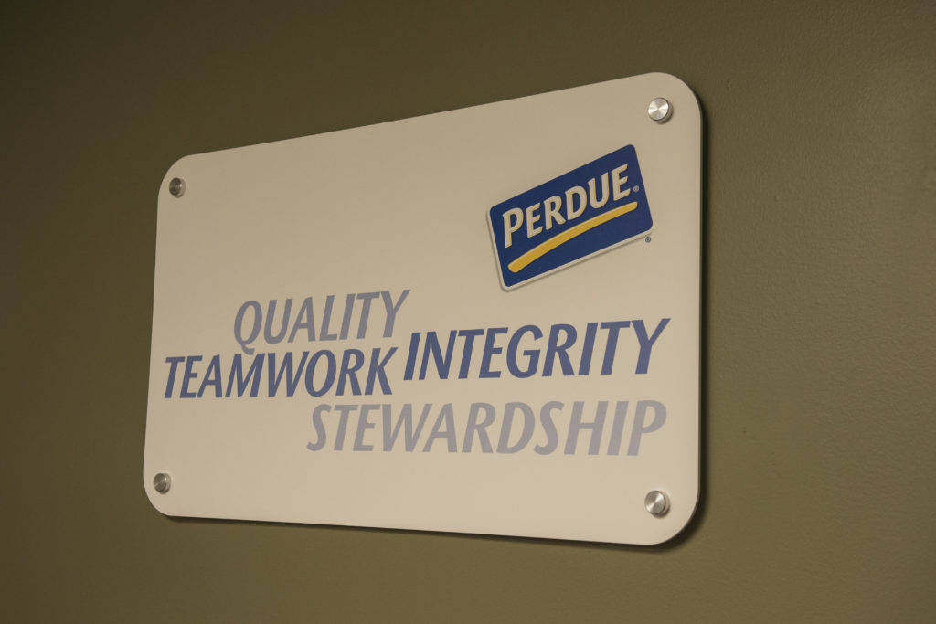 A sign in the company's headquarters reminds employees about some of the company's values.