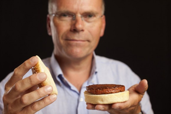 Dr. Mark Post of Mosa Meats holds a 'clean meat' hamburger grown from cell culture. Clean meat is produced without the use of antibiotics and hormones and eradicates animal waste management and thus air and water pollution problems.  Image source: The Good Food Institute