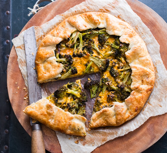 A savory pie without the fuss, a galette can be thrown together with whatever vegetables, cheeses, or spreads you have on hand. In this recipe, the broccoli lends a nice crunch to contrast with the soft dough. Pair with a salad and you've got dinner. Photo source:  White on Rice Couple .