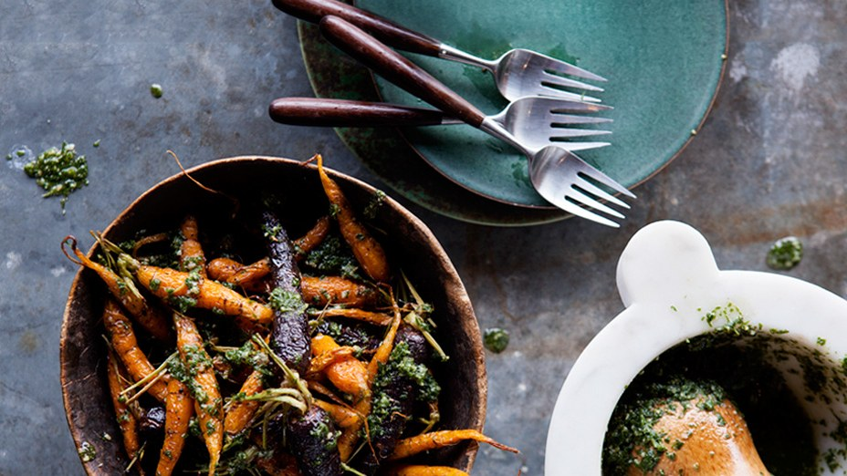 Looking for a way to use all those carrot tops? Try   Roasted Carrots with Carrot-Top Pesto   .  The pesto goes beautifully with pasta, too.  Image source