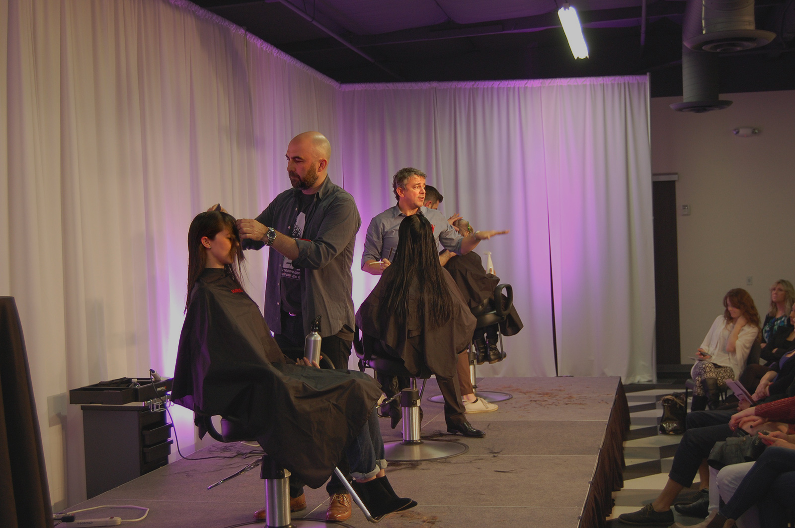 - James teaching on stage with Nick Arrojo and Adam Federico atArrojo's Happy Mondays held at the Federico Beauty Institute in Sacramento.