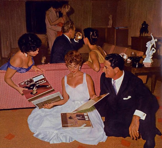 May 1959 Playmate of the Month posed at a record party