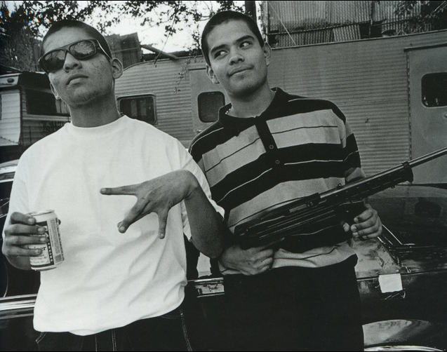 LA gang sign and gun