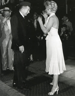 Marilyn with director Billy Wilder, planning the skirt-blowing scene (Sept. 1954)