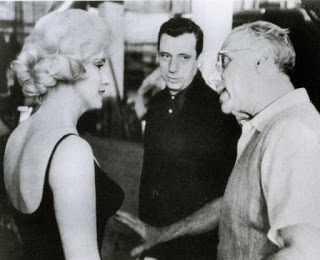 Arguing with George Cukor, famous comedy director, on the set of  Let's Make Love  (1960)