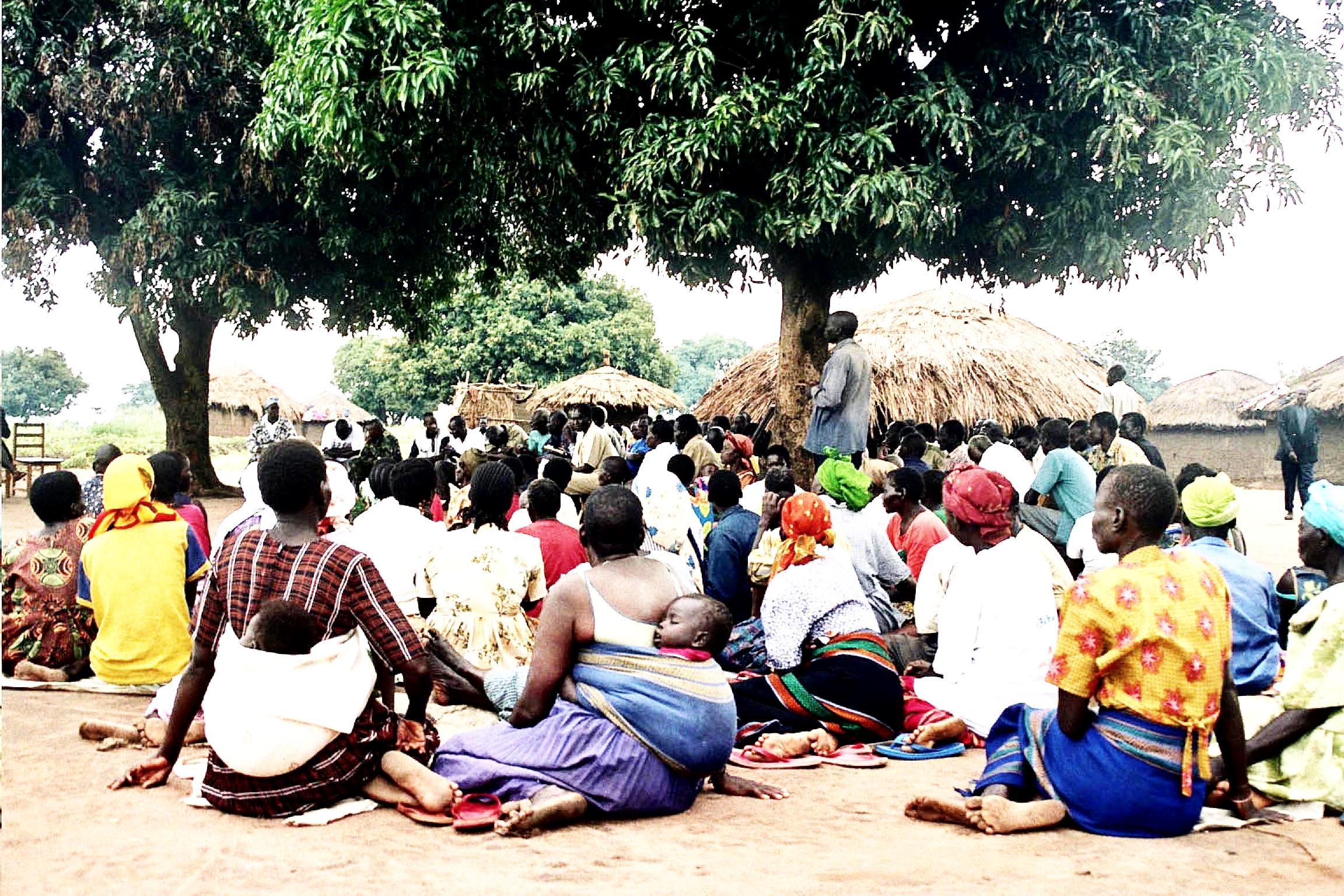 men-women-and-children-on-meeting-in-rural-village.jpg