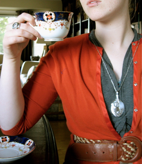 kelsey with folded pendant and ring with teacup.jpeg