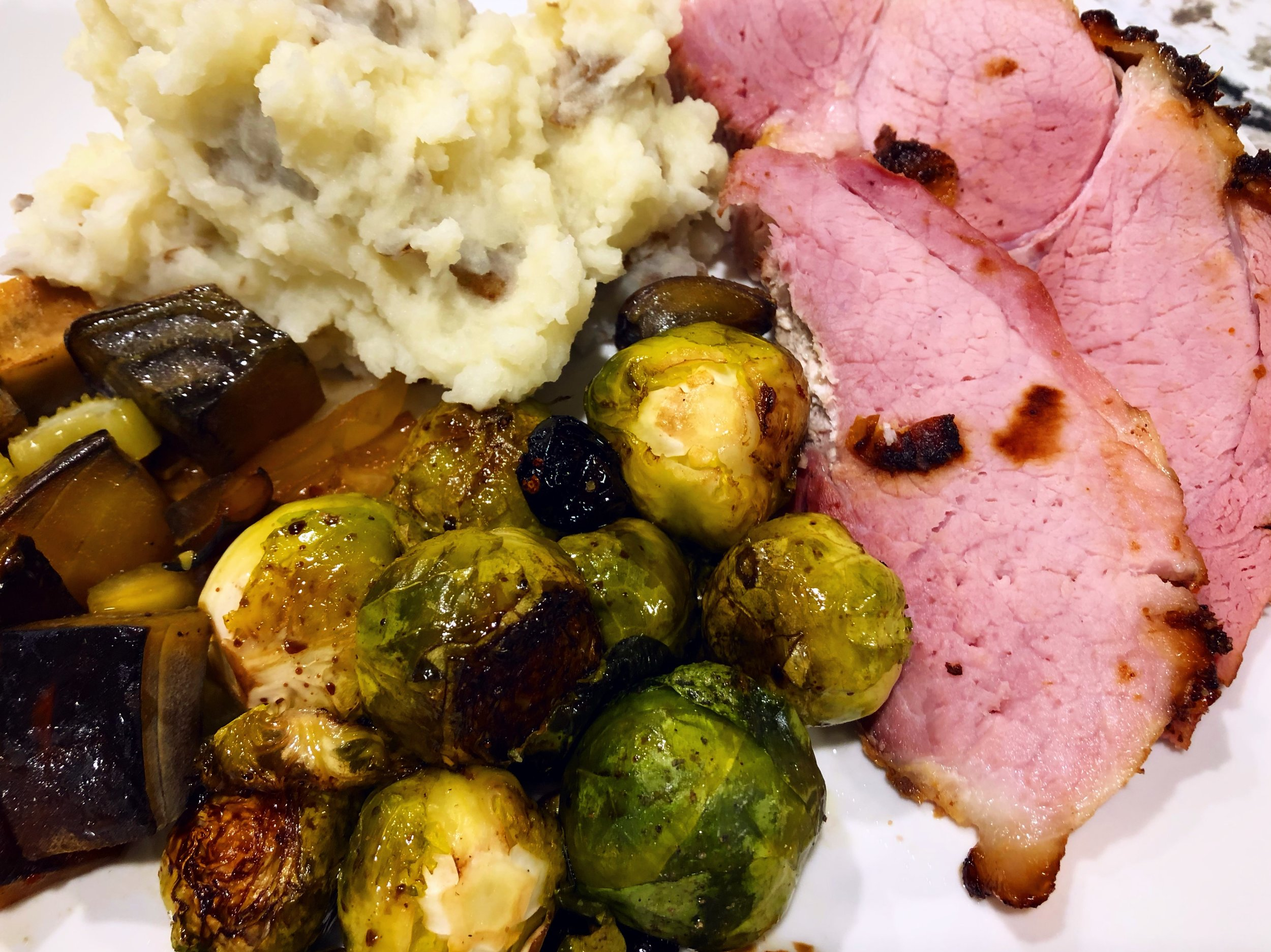 Epiphany dinner this year was ham, mashed potatoes, roasted veggies (roasted in the pan underneath the ham for maximum deliciousness), and Brussels sprouts (roasted with olive oil, balsamic vinegar, and dried cranberries).