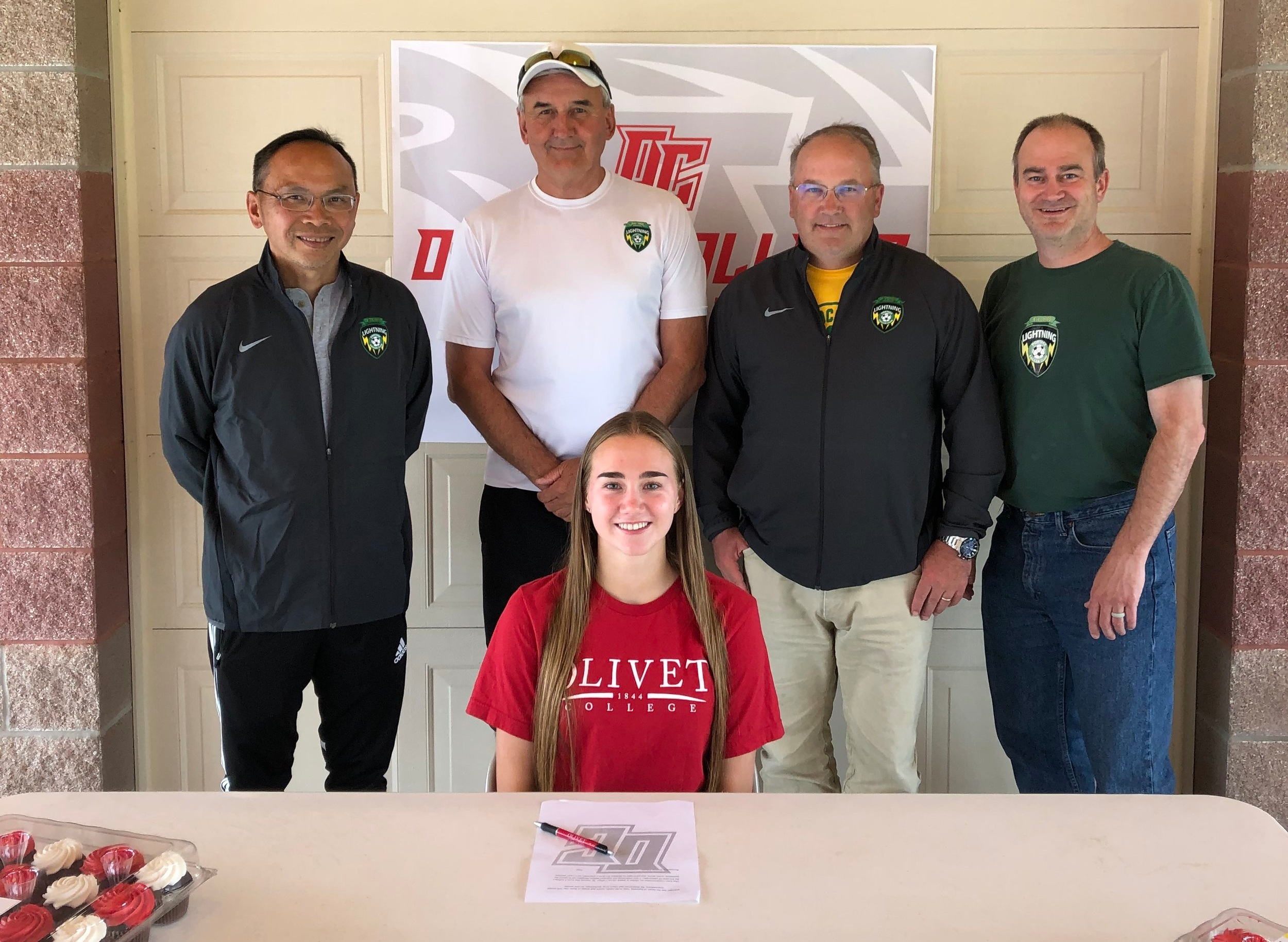 Mary Mitchell, PSC 01 Green Girls Team, signing ceremony for Olivet College