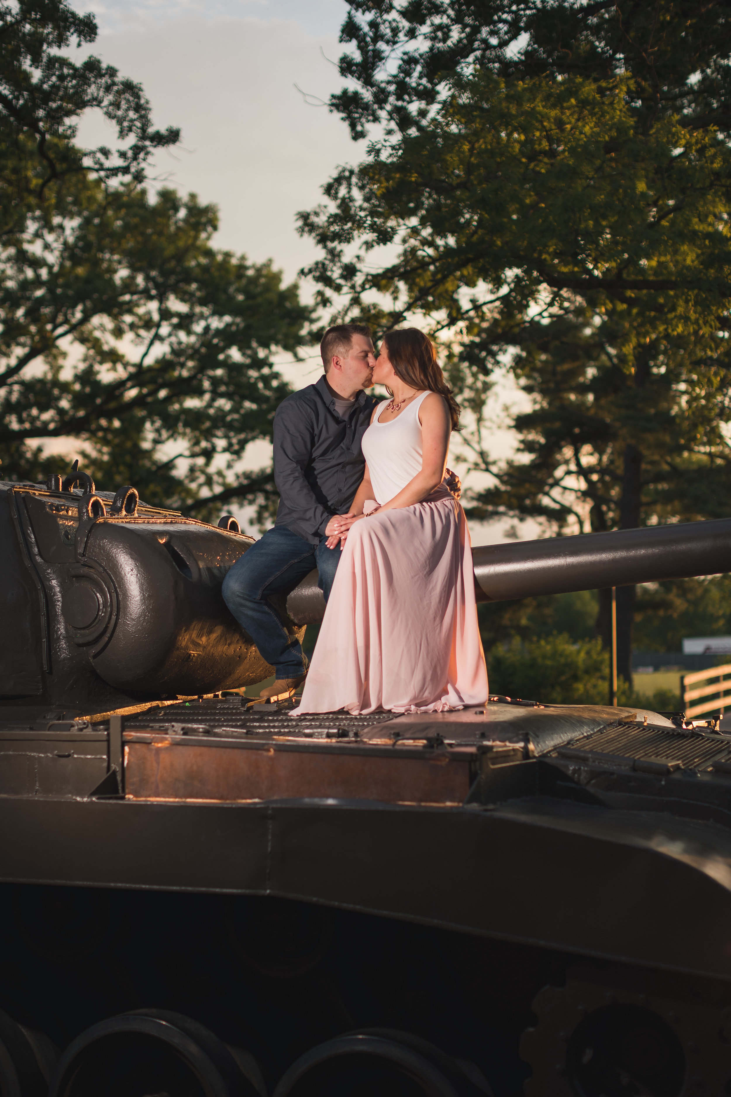 - Both Kelly and Kyle laughed throughout the shoot, which made it easy to capture genuine emotions and you could see the love they have for each other. There are many gorgeous spots to take pictures at Cantigny Park and we just about hit them all during our three hour session. One of my favorites is the one with the tank! I mean, it's not everyday you can take a picture while sitting on a tank.
