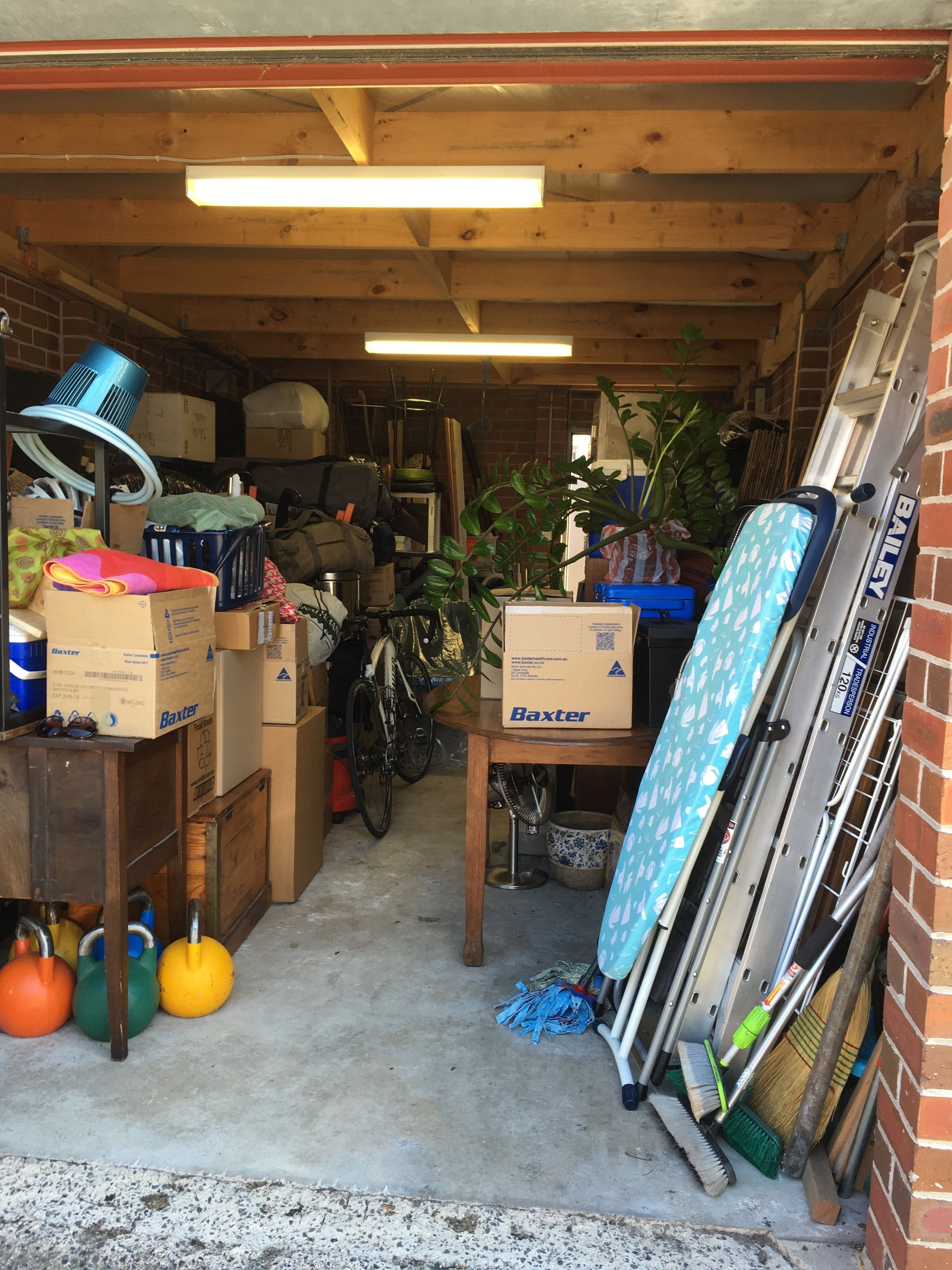 All of our worldly possessions crammed into the garage - another unpleasant side effect of renovations not running on schedule!