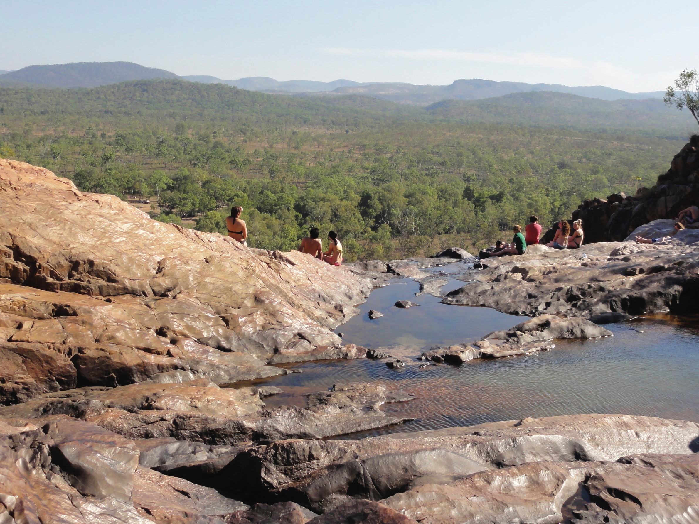 This is the incredible Gunlom Falls in Kakadu National Park! Well, well, well, it's a pretty spectacular spot as you can see. That's me sitting on the far left taking in the view. It's quite a steep hike to the top but then you're rewarded with a series of pools to cool down in. Below is a large pool that the falls drop into and it's corcodile territiory too, so it pays to be very cautious.