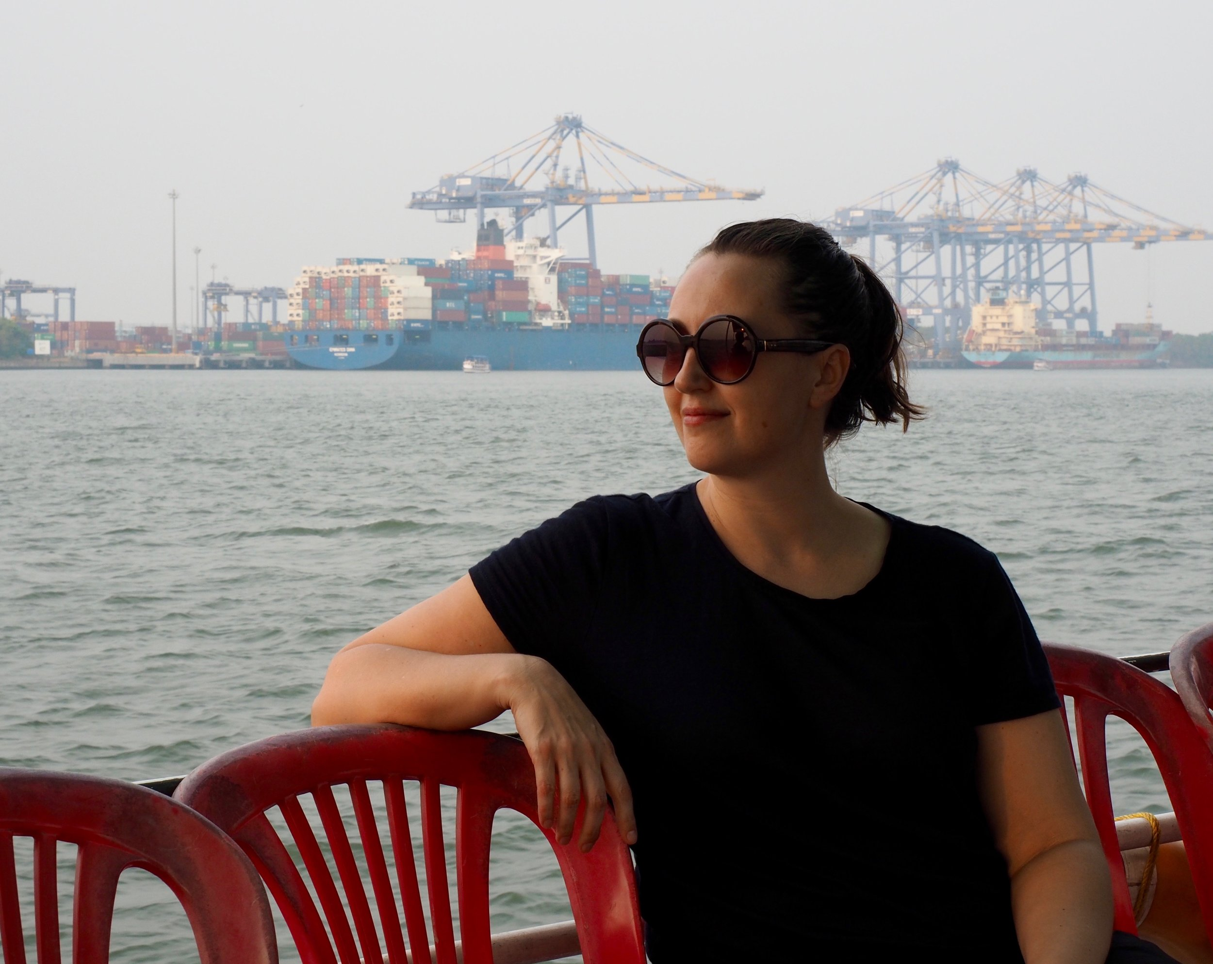 Here I am sitting on a tourist boat in a major shipping port in Kochi, Kerala. I'm sporting a comfortable ponytail that requires virtually no skill and very little time to execute - perfect for me!