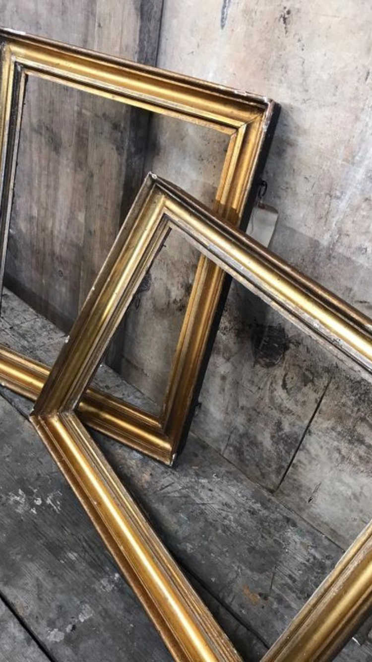 A pair of classic gold antique picture frames