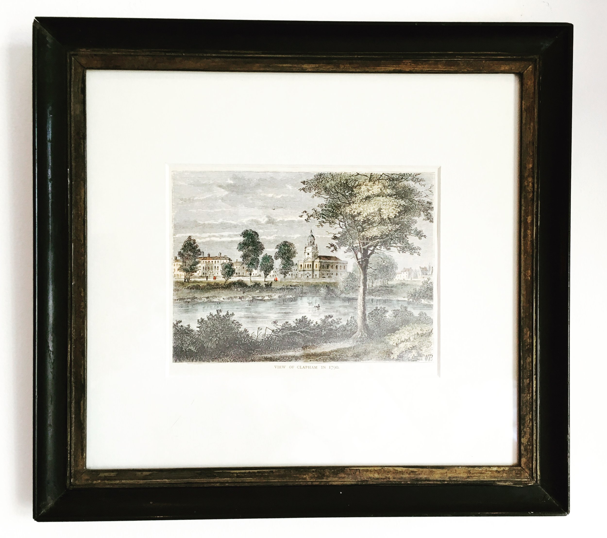 Small vintage frame around a lovely water colour landscape painting.