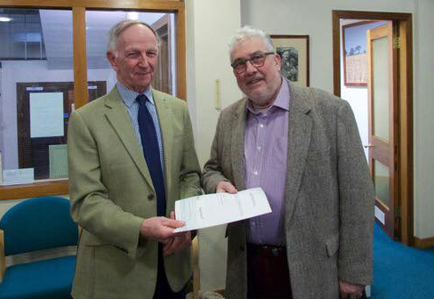 Friock Hub Chairman Dougie Pond receiving donation from the Trust.
