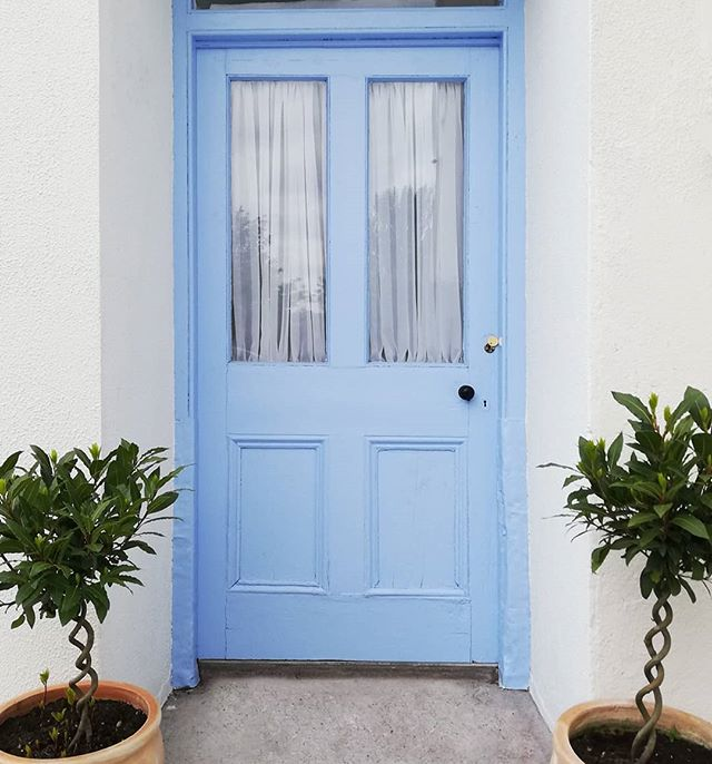 #beforeandafter lovely #lulworthblue from @farrowandball  Years and layers of paint stripped. Delighted to keep the original door. Hubby did good 💙. . . . . . . ... . . . #bluedoor #blue #powderblue #doorsofinstagram #bluedoors #frontdoor #backdoor #baytrees #makeanentrance