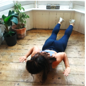 From here lift your legs and upper body off the floor as you pull arms back tucking your elbows into your ribs and squeeze your shoulder blades together.