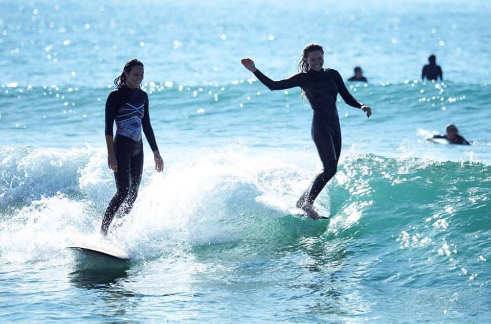Surfer on the right has 'dropped' in - fine if you're friends, naughty if you're not.