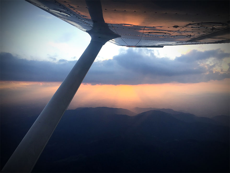 """Asheville, North Carolina, August 2016 — """"…nurturing the aircraft higher and higher into the sky against the backdrop of the setting sun."""""""