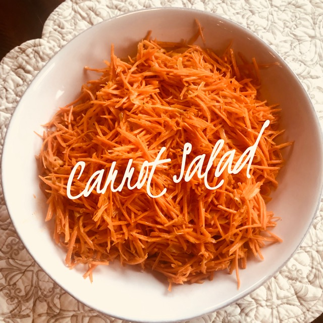 Recipe:  4 large carrots  1/4 cup olive oil  1 clove garlic  1 small onion thinly sliced  2 tbsp. apple cider vinegar  1 tsp coconut sugar or honey  1 1/2 tsp coriander  1/2 tsp chili powder  1/2 tsp salt  pepper to taste    Shred carrots using a julienne grater (cheese grater will work but make smaller carrot shreds). Sauté thinly sliced onions in olive oil and garlic until soft. Add onion and oil to shredded carrots. Add other ingredients and stir. Serve at room temperature. Even better the next day!